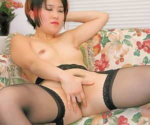 Stocking clad Asian first timer masturbates hairy twat after panty removal