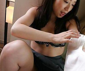Wonderful brunette asian milf Eriko showing hairy pussy