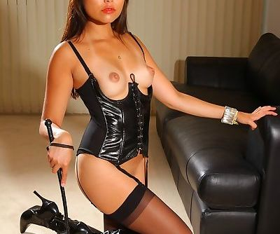 Incredible domina Petra So poses in stockings and leather outfit