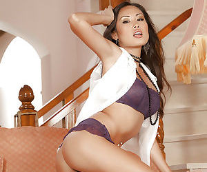Asian babe Beverly is teasing her pussy on a comfortable couch