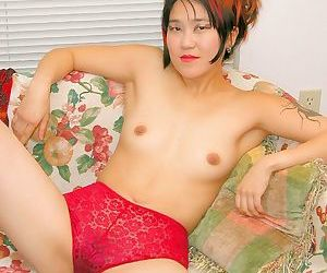 Asian amateur in high heels with small breasts reveals hairy vagina