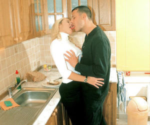 Adorable blonde babe gives a blowjob and gets shagged in the kitchen