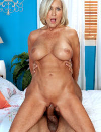 Hot older blonde Katia takes a big black cock in all of willing holes