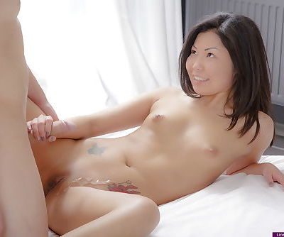 Tiny Asian girl gets splashed with cum while fucking her boyfriend