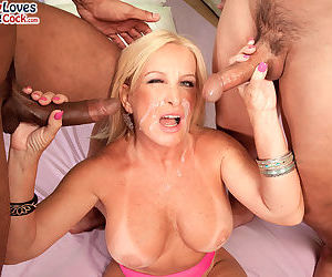 Hot blonde granny Julia Butt gets ass fucked during an interracial MMF 3some