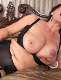 Mature lady Jessica Hot seduces a younger gentleman in her lingerie