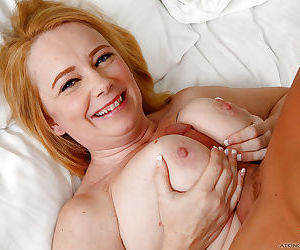 BBW Brandie Sweet giving blowjob with big saggy boobs hanging in wind