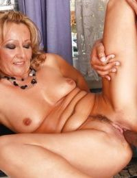 Stunning mature blonde with tiny tits sucks and fucks a big black boner