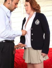 Redhead teen Cammie Fox is relieved of her schoolgirl uniform before fucking