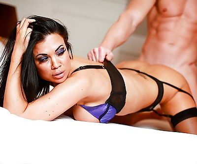 Stockings model Jasmine Jae is enjoying a hardcore sex with her man
