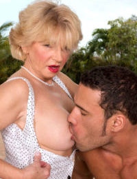 Older woman DeAnna Bentley takes her young lovers cock in her asshole