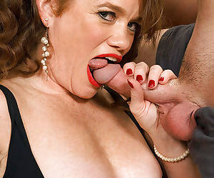 Horny mature in black stockings Ciara Red sucking and fucking a big cock