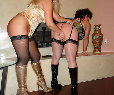 Two lesbian moms in stockings and high heels boots licking ass and pussy