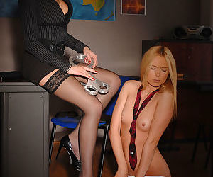 Dyke teacher in glasses coerces young blonde into lezdom sex games