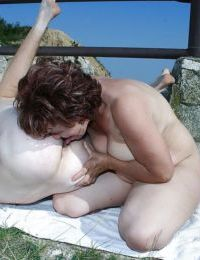 Mature big titted babe strips outdoor to fuck with a hot young guy