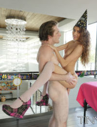 Petite teen Rebel Lynn gets banged by a large cock on New Years