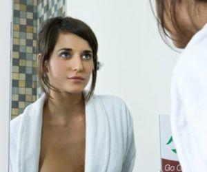 Brunette teen Irina B takes a dip in bathtub between showers