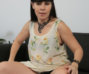 Chubby middle-aged woman Malavi Mepanse undresses for hairy pussy play on sofa