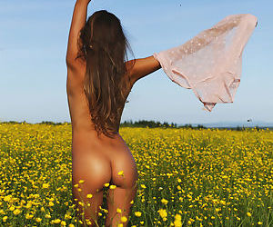 Country girl Mango A loses her shorts to crawl around nude in the sunny field