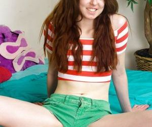 Teen redhead with a skinny body spreads her hairy pussy opening a love tunnel