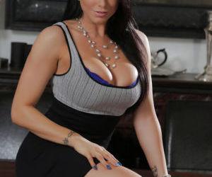 Buxom Latina pornstar Romi Rain strips for viewing of tattoos and nice ass