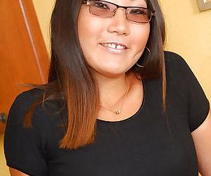 Asian amateur Miki flashing pink underwear on kitchen countertop