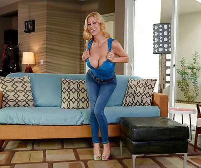 Blonde MILF pornstar Alexis Fawx peeling off blue jeans to model naked