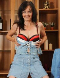 Middle aged brunette Renie undresses for fun times with her horny pussy