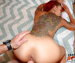 Tattooed Asian redhead Kimberly having sex with massive penis