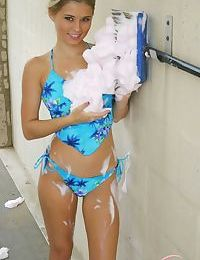 Clothed amateur Jannah Burnham gets covered in suds at the local car wash