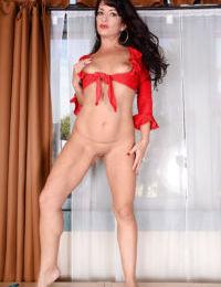 Older brunette model Gabrielle Lane revealing small tits in cutoff shorts