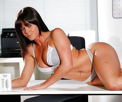 Leggy brunette chick Rahyndee James wandering around office in underwear