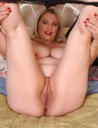 Mature fatty Twani squeezes big knockers together in tight dress