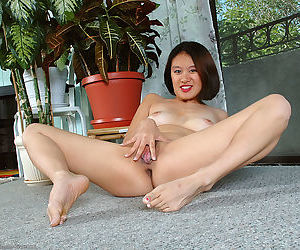 Amateur babe with small breasts spreading trimmed Asian pussy on knees