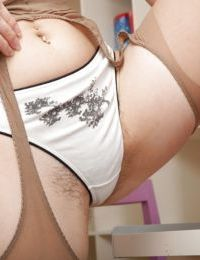 Seductive teen babe in glasses Miki taking off her clothes