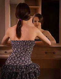 Brunette teen Anna B admires her smooth pussy in bedroom mirror