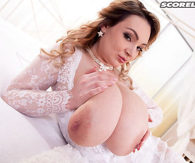 Plump solo model Micky Bells works free of lace clothing to masturbate