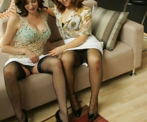 Gorgeous mature babes in stockings slowly uncovering their sexy bodies