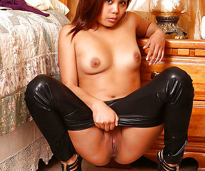 Oriental babe Mimi modelling in sexy black latex pants and high heels