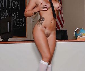 Barely legal slut Jenna Ashley lifts pleated schoolgirl skirt to spread