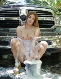 Redhead woman Blake Eden pours water on her body and washes her pussy