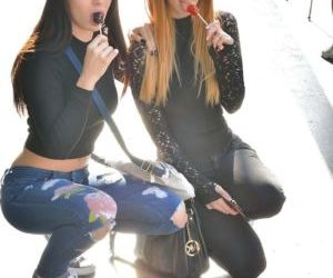 Lesbian teen girls injeans kissing- pissing and toying with dildo in public