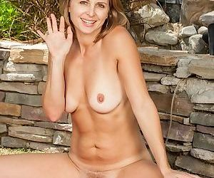 Close up posing scene of a mature beauty Melissa Rose outdoor
