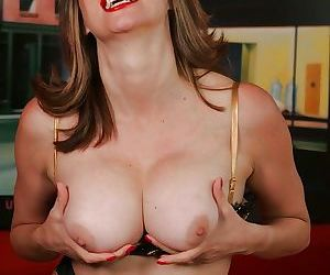 Adorable mature babe Abigail Fraser stripping and exposing her big tits