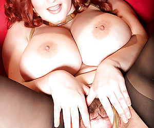 Chesty redhead fatty Vanessa Y spreading hairy pussy in stockings