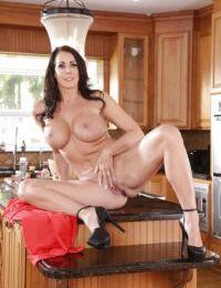 Older wife Reagan Foxx letting round boobs loose on kitchen countertop