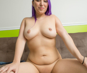 Purple haired girl in tight jeans flaunts her fatty ass naked on her knees