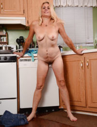 Leggy mature broad Cristine Ruby frees tiny tits and hairy cunt in kitchen