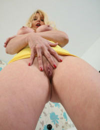 Older blonde lady Lucinda works herself free of hose before masturbating