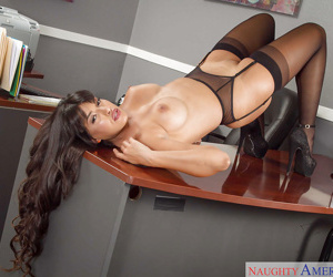 Dark haired Latina babe Mercedes Carrera makes a hot office striptease